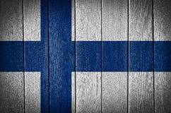 Finland Flag. Painted on wood plank background royalty free stock images