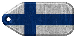 Finland Flag. Painted on wood tag. isolated on white background stock image