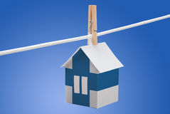 Finland flag. On a paper house. Concept Stock Photos