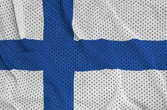 Finland flag printed on a polyester nylon sportswear mesh fabric. With some folds royalty free stock photography