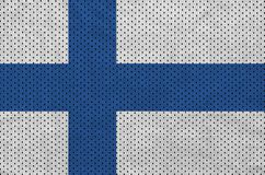 Finland flag printed on a polyester nylon sportswear mesh fabric. With some folds royalty free stock photos