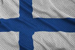 Finland flag printed on a polyester nylon sportswear mesh fabric. With some folds stock image