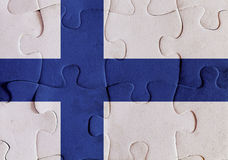 Finland flag puzzle. Illustration of a flag of Finland over some puzzle pieces. Its a JPG image Royalty Free Stock Images