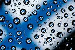 Finland flag. Reflection of Finland flag in water droplets Stock Photos