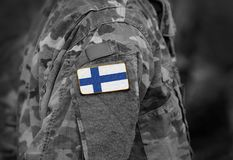 Finland flag on soldiers arm collage.  royalty free stock photo
