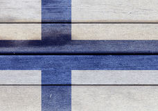 Finland flag on a wood. Illustration of Finland flag over a wooden textured surface Royalty Free Stock Images