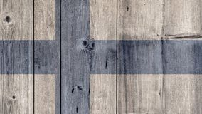 Finland Flag Wooden Fence. Finland Politics News Concept: Finnish Flag Wooden Fence royalty free stock photography