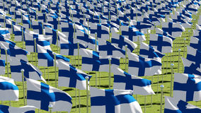 Finland Flags on flagpoles in green field. Many Finland Flags on flagpoles in green field. View from above. Three dimensional rendering illustration Stock Photo
