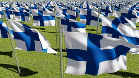 Finland flags waving in green field. 3d rendering of Many Republic of Finland flags waving in green field. View from above. Three dimensional rendering Royalty Free Stock Photo