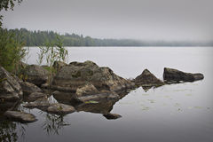 Finland: Foggy morning by a lake royalty free stock image