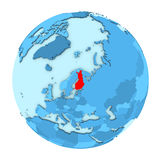 Finland on globe isolated. Finland in red on simple political globe with clearly visible country borders. 3D illustration isolated on white background Royalty Free Stock Image