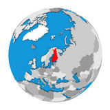 Finland on globe. Map of Finland highlighted in red on globe. 3D illustration isolated on white background Stock Photos