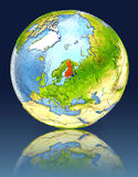 Finland on globe with reflection Stock Images