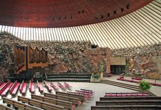 Finland - Helsinki - Austere interior of Temppeliaukion kirkko or church in the rock, beautiful temple built inside the rock. And stone and massively vaulted by royalty free stock image