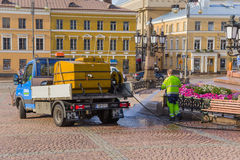 Finland, Helsinki. Employees of the municipal services watered flowers Stock Image