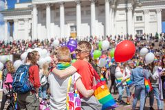 Finland, Helsinki, June 30, 2018, a lesbian couple against a background of pride and crowd. Human rights, equality, festival stock image