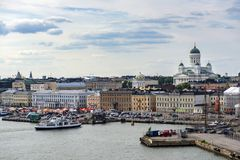 Finland, Helsinki - June 30, 2013: a panoramic view of the center of Helsinki from the ferry. Welcome to Finland, Helsinki - June 30, 2013: a panoramic view of royalty free stock photography