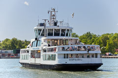 FINLAND, HELSINKI - JUNE 15, 2011: Small ferry Suomenlinna II moves tourists from Helsinki to Suomenlinna fortress Royalty Free Stock Image