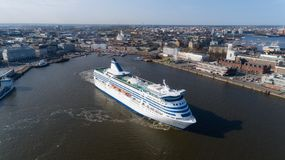 Finland, Helsinki. Summer evening. The ship, white cruise passenger liner, leaves the city port. Panorama of the capital, view on stock photo