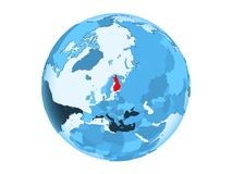 Finland on blue globe isolated. Finland highlighted in red on blue political globe with transparent oceans. 3D illustration isolated on white background Royalty Free Stock Photography
