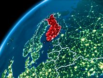 Map of Finland at night. Finland highlighted in red from Earth's orbit at night with visible country borders. 3D illustration. Elements of this image furnished Stock Images
