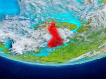 Finland on globe from space. Finland highlighted in red on planet Earth with clouds. 3D illustration. Elements of this image furnished by NASA Royalty Free Stock Images