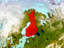Finland on illustrated globe. Finland highlighted in red on illustrated globe with realistic ocean waters and clouds as seen from Earth's orbit in space. 3D Stock Photos