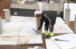 Finland: Sauna Construction - Insulation. A worker insulates the base of a sauna terrace with urethane foam sheets against the low winter temperatures prevalent stock photos