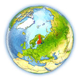 Finland on isolated globe. Finland highlighted in red on 3D globe with detailed planet surface and blue watery oceans. 3D illustration isolated on white Royalty Free Stock Images