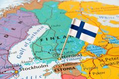 Finland man and flag pin. Paper flag pins of Finland, map of Nordic countries, Northern Europe Stock Photos