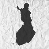 Finland map in black on a background crumpled paper Stock Images