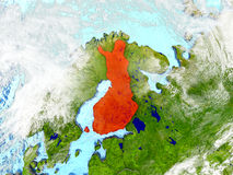 Finland on map with clouds. Finland in red on map with detailed landmass texture, realistic watery oceans and clouds above the surface. 3D illustration. Elements Stock Photography