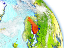 Finland on model of Earth. Finlandin red color on model of Earth. 3D  illustration with detailed planet surface, clouds and reflective ocean waters. Elements of Royalty Free Stock Images