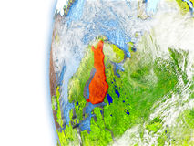 Finland on model of Earth. Finland highlighted in red on planet Earth with visible waves in the oceans and clouds in the atmosphere. 3D illustration with Royalty Free Stock Photo