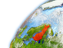 Finland on model of planet Earth. Finland highlighted on model of planet Earth. 3D illustration with reflective waters and clouds in the atmosphere. Elements of Stock Photos