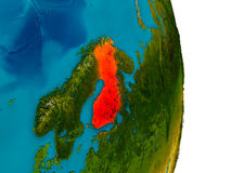 Finland on model of planet Earth. Finland highlighted in red on detailed model of planet Earth. 3D illustration. Elements of this image furnished by NASA Stock Photography