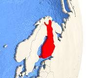 Finland on model of political globe. Map of Finland on globe with blue watery seas. 3D illustration Stock Photos
