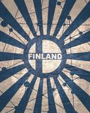 Finland flag concept. Finland national flag on sunburst background. Card template for national holiday celebration. Red and white rays textured by lines with royalty free stock images