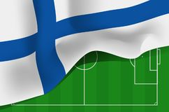 Finland national waving flag on football field background. Finland national waving flag. Symbol of Suomi on football field background Stock Image