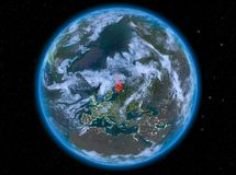 Finland at night on Earth. Night view of Finland highlighted in red on planet Earth with atmosphere and clouds. 3D illustration. Elements of this image furnished Stock Photos