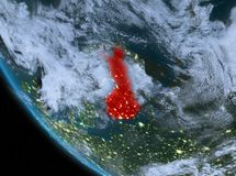 Night view of Finland on Earth. Finland at night highlighted in red on planet Earth with clouds. 3D illustration. Elements of this image furnished by NASA Stock Photos