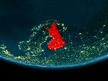 Night over Finland on Earth. Finland at night highlighted in red on planet Earth. 3D illustration. Elements of this image furnished by NASA Royalty Free Stock Image
