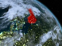 Finland at night from orbit. Night above Finland highlighted in red on model of planet Earth in space. 3D illustration. Elements of this image furnished by NASA Stock Photo