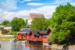 Finland. Old red wooden houses and trees. Porvoo landscape. Small historical town in Finland. Old red wooden houses and trees on the coast Stock Photo