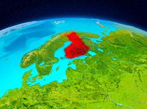 Finland from orbit. Satellite view of Finland highlighted in red on planet Earth. 3D illustration. Elements of this image furnished by NASA Royalty Free Stock Photos