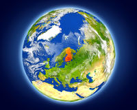 Finland on planet Earth. Finland highlighted in red on planet Earth. 3D illustration with detailed planet surface. Elements of this image furnished by NASA Royalty Free Stock Images