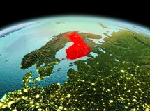 Finland on planet Earth in space. Morning above Finland highlighted in red on model of planet Earth in space. 3D illustration. Elements of this image furnished Stock Photos
