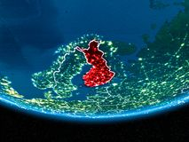 Finland on planet Earth from space at night. Finland in red with visible country borders and city lights from space at night. 3D illustration. Elements of this Stock Photo