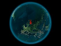 Finland on planet Earth in space at night. Night above Finland highlighted in red on model of planet Earth in space. 3D illustration. Elements of this image Stock Photos