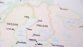 Finland on a Map. Finland on a political map of the world. Video defocuses showing and hiding the map stock footage